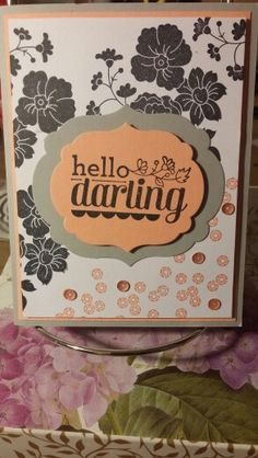 Stampin' up Hello darling card Materials: Cardstock: crisp cantaloupe, whisper white, and smokey slate Inks: crisp cantaloupe and StazOn jet black Framelits label collection dies 2 and 3 from middle In color sequins Dimensionals CASED