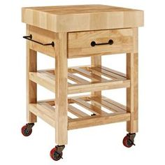 """Showcasing 2 open shelves and casters for versatility, this essential kitchen cart features a butcher block top and convenient towel bar.  Product: Kitchen cart Construction Material: Solid hardwood, metal and wood veneersColor: NaturalFeatures:  Four locking castersOne towel barOne drawer Two slatted open shelvesDimensions: 34.4"""" H x 24"""" W x 24"""" D"""