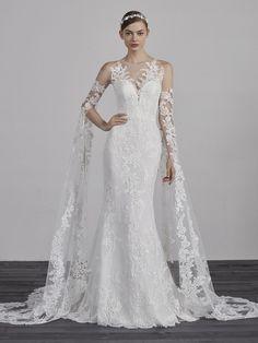 Long sleeve lace illusion cold shoulder mermaid wedding dress. | Pronovias | Style: ERIADU