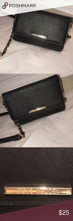 """Steve Madden purse/crossbody black Black Steve Madden crossbody purse with partial gold chain strap. Has only been used 3 times as my """"go out"""" purse where I only bring my ID and cards/cash. Has a built in wallet (lots of slots) as well as zipper pouch inside to keep things in certain spot. Has some marks/discoloration on front that is barely noticeable!! See last picture Steve Madden Bags Crossbody Bags"""