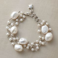PRESENT DAY PEARL BRACELET--Au courant pearls by London artist Eric Van Peterson. Three sterling silver strands mingle big baroque gems with smaller exemplars. Handmade with cultured freshwater pearls. Lobster clasp.
