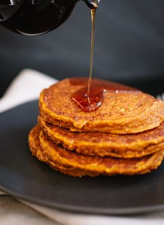 Pumpkin Oat Pancakes - These fluffy, healthy pumpkin pancakes are laced with hearty oats and warming spices. Since they are made with oat flour, they are gluten free!