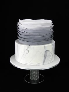 Grey marble birthday cake with signature white sugar flower by The