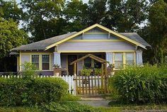 American Bungalows come in many shapes. This colorful bungalow in Texas has a spacious porch with a wide gable facing the street.