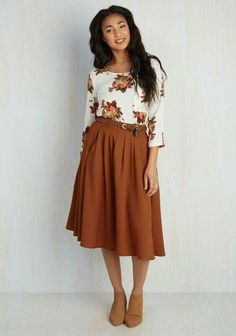 Really like this skirt. I've never worn blouses tucked into the waistband, but may try it with a belt.