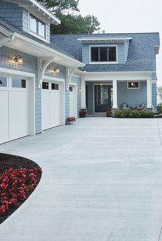 Sky blue house white trim grey blue door brown roof for Beach house gray paint colors