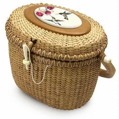 Nantucket Basket Bag.  Back in the  days of my childhood Ivory was carved for the tops.  No more ivory anymore.