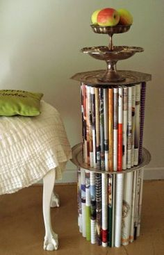 Elle Decoration SA: Guest blog: Book Art! I've written up a tutorial on my blog, explaining how to make this side table with your own collection of magazines, so do pop over to see. And who knows, perhaps the dusty paperback novels on your bookshelf might just be ready for their Second Debut!