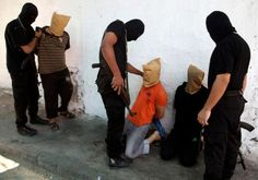 Hamas operatives prepare to execute alleged collaborators in the Gaza Strip Photo By: REUTERS