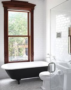 :: Havens South Designs :: free standing tubs on legs, big windows, floor to ceiling tile contrasted with smaller marble mosaics on the floor, pedestal sinks and glass showers all help make a smaller bath seem so much larger.