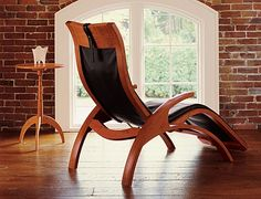 This wood recliner looks way too comfy...