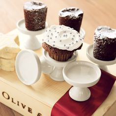 Petite pedestals are just the right size for a little bit of cupcake bliss. Creamy colored cupcake stands dress each place setting with a bit of unexpected splendor. Stands measure 2 1/2 x 3 and come gift wrapped in a hand crafted wood crate with ribbon.