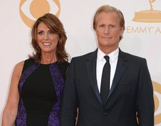 """Breaking! Jeff Daniels caused one of the night's biggest upsets after winning Outstanding Actor in a Drama for """"Newsroom."""" Here, he poses with his wife Kathleen Treado on the red carpet prior to the awards show."""