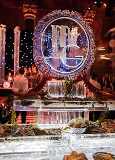 The Colin Cowie Celebrations team put on a lavish affair for this Great Gatsby inspired celebration. An over-the-top seafood display and absinthe bar helped to start the first chapter of the evening, and a 1920's inspired flapper swinging from a crystal chandelier kicked the party into high gear.