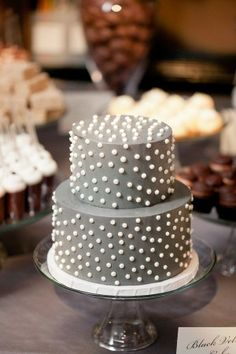 Two tier gray round cake with white dots