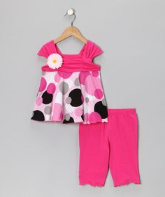 Perfect for bright-eyed little gals, this set's tunic showcases a vibrant print and blooming flower pin. Stretchy knit cotton and coordinating capri leggings keep it comfy enough for the playroom, while sweet styling makes it spiffy enough for dressier occasions.Includes tunic and leggings100% cottonMachine wash; tumble...