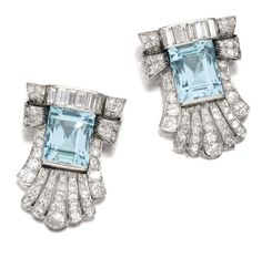 AQUAMARINE AND DIAMOND DOUBLE-CLIP BROOCH, 1930S. Each palmette-shaped clip centring on a step-cut aquamarine, further set with circular-, single-cut and baguette diamonds.