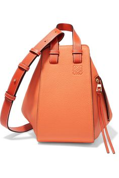 1737c6b2af Orange textured-leather (Calf) Hook fastening at open top Designer color   Apricot Comes with dust bag Weighs approximately Made in Spain