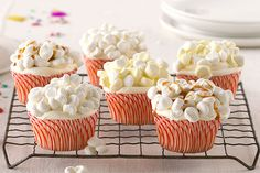 """Having a movie night in with your family tonight? Whip up these adorable """"Popcorn""""-a-Plenty cupcakes using @coolwhip for a pop-tastic ttreat they'll totally devour!   @kraftrecipes"""