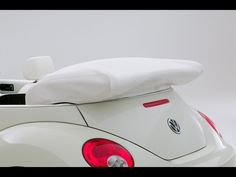 2007 Volkswagen New Beetle Convertible Triple White Special Edition.    My first car was a 1963 VW Bug.  I just turned 16 and got it as a hand-me-down from my mom.  I loved that car.  It represented adventure and freedom and opened my world. I don't think anyone ever loves a car like your first car.