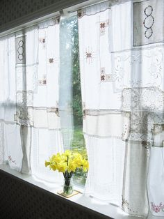 vintage hanky curtains -- LOVE. I think I may have to try this in my new living room!  Wonder if I can dye them them?