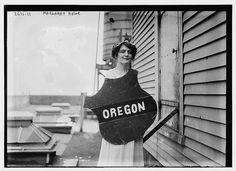 Mrs. Margaret Howe holds the emblem representing the Oregon delegation at a women's suffrage parade in 1913 in Washington DC. At this march/ parade, the women held banners representing states that already had women's suffrage. Oregon women obtained the right to vote in 1912.