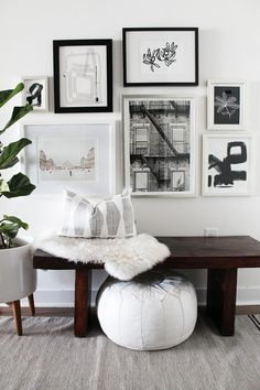 Inspiring Black And White Gallery Wall Entryway With Dark Wood Bench Desing Ideas
