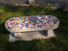 concrete bench with scrap stained glass