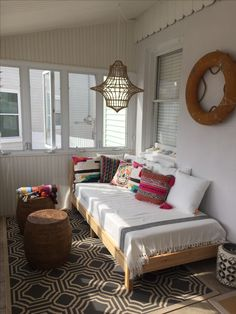 Beach house porch with boho daybed lots of pillows & hanging jute rope lamp #summer #porch #daybed IKEA tarva