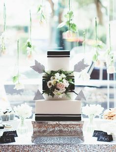 black and white arrow cake + hanging flower backdrop
