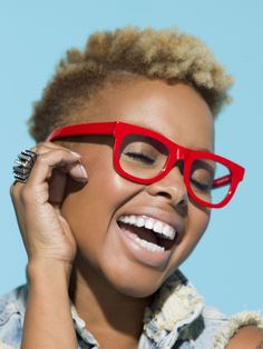 She is too cute! I love her glasses and smile and hair. Chrisette Michele... love her!
