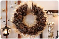 Pine cone and book page wreath.    Would be great with sheet music...tuturial at the link below.    http://myblessedlife.net/2010/12/pine-cone-book-page-wreath.html
