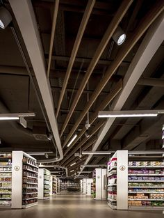 Ends of the aisles have a nice design element, feels more special than typical grocery shelving.  Spar supermarket in Budapest by LAB5 architects
