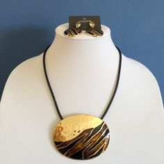 Necklace & Earrings Set This beautiful set is sure to make a statement!  The hammered gold, black and brown on the necklace is an amazing combination.  This set has never been worn. No tag on the necklace, but tag shown for earrings in picture #4. Chico's Jewelry Necklaces