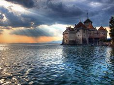 It is Château de Chillon in Veytaux (outside Montreux), Switzerland