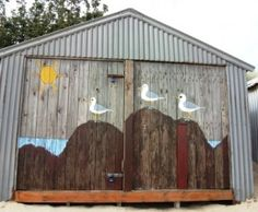 beach hut with painted seagulls