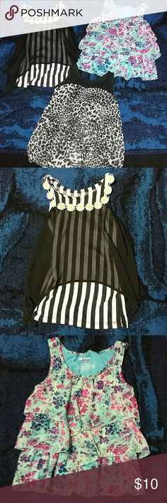 Three cute tops All tops are in good condition.  Black/white stripes with flowers - size Large 6x Blue with flowers - size 6 Black with cheetah pattern - size XS (same as size 6) Shirts & Tops