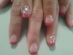 Pokadot Nails!  Acrylic nails with hand painted coral French tips with hand painted pokadot nails in ring fingers and gel top coat.