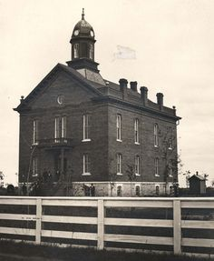 HISTORIC PHOTO - Completed in June 1973, Hall County's original courthouse was believed to have been the third brick courthouse in Nebraska.  The two and a half story brick building occupied the block now used as Pioneer Park, bounded on the north by West Second Street, the west by Cleburn Street, the south by West First Street, and the east by Elm Street.  The clock tower was removed in the mid-1880s.  This courthouse was abandoned and eventually razed after the opening in 1904 of today's…