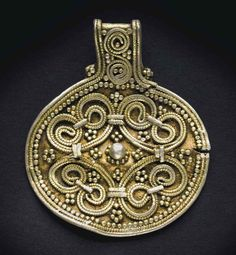Lot 125 A VIKING GILT SILVER PENDANT | CIRCA 10TH CENTURY A.D. 1 ½ in. (3.8 cm.) high | Ancient Art & Antiquities, jewelry | Christie's Estimate USD 8,000 - USD 12,000