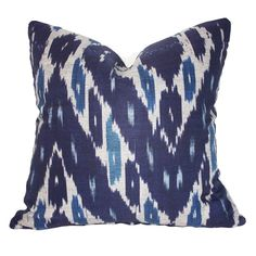 This is a gorgeously FAB  Navy and soft Teal Ikat print pillow in a high quality cotton / Linen blend fabric.    It comes with the feather down insert.   This is a great decorator piece to enhance your love of navy and blue in your comfy surroundings.  Great for sofa,  club chair or even bed décor!