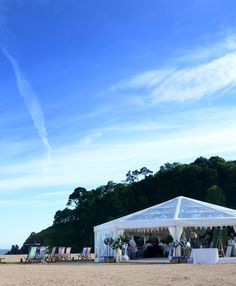 Looking for a beach wedding venue? A marquee at Blackpool Sands will provide breathtaking beach and coastal scenery as the backdrop to your wedding day. Wedding Ceremony Marquee, Wedding Table Seating, Wedding Venues Beach, Wedding Table Flowers, Beach Weddings, Wedding Ideas, Devon Beach, Flower Table Decorations, Marquee Lights