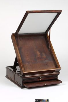 Miniature-painter's box | V&A . . .believed to have belonged to Richard Crosse (1742-1810). A frame at the top probably contained a piece of ground glass or some other material to diffuse the light. Below this is a little ledge of which the painter placed his ivory while he was at work. In the compactly arranged drawers the painter kept his colours, palette, etc.