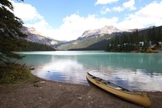 Find a canoe in Canada and paddle on Emerald Lake.