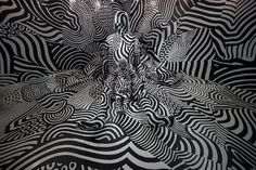 Using World War I-era dazzle painting, Japanese artist Shigeki Matsuyama turns a room into mind-bending visual experience.