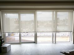Sunscreen roller blinds - floor to ceiling windows