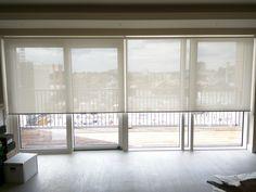 Sunscreen roller blinds - floor to ceiling windows