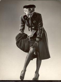 Google Image Result for http://ieatfashionforbreakfast.com/wp-content/uploads/2011/10/gjon-mili-model-wearing-black-stockings-fitted-dress-coat-fur-trimmed-hat-and-fur-muff-adjusting-garter.jpg