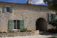 Entter through the ancient doorway into Chateau de Puissentut.