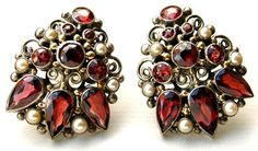 Dorrie Nossiter. Arts and Crafts clip brooches. Silver, garnet and pearl, c. 1930. Fitted case. Sold by Tadema Gallery.